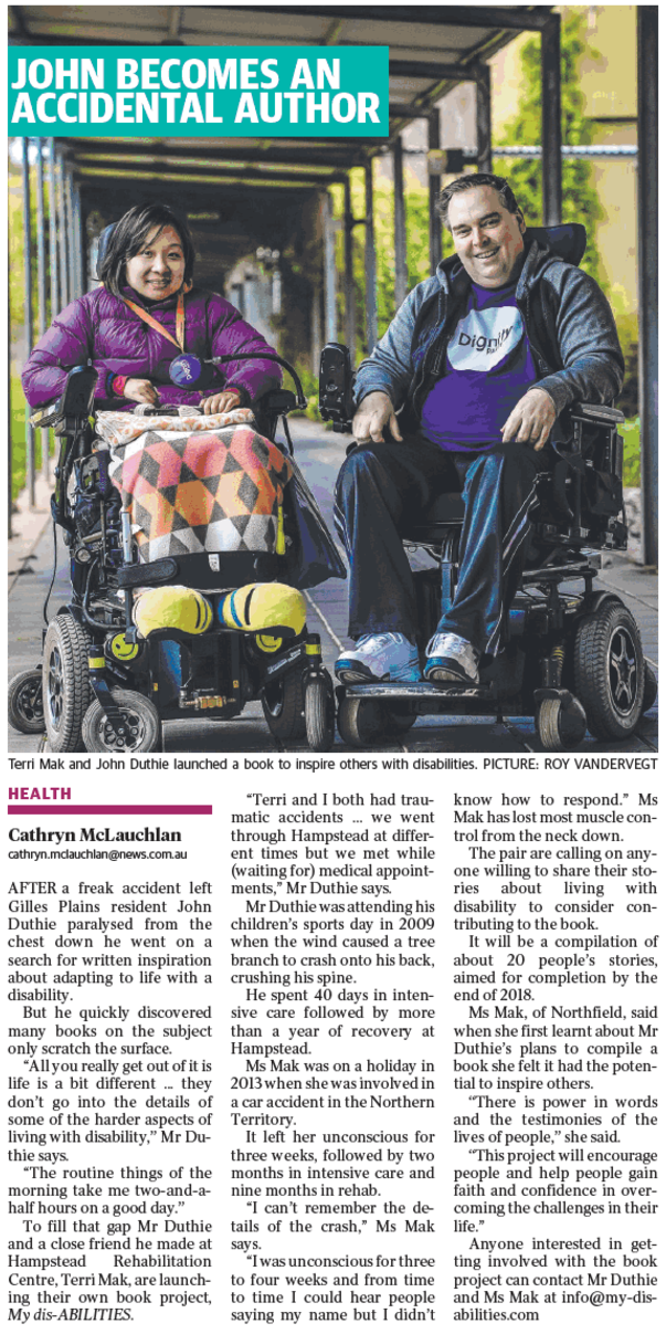 Terri and John in wheelchairs. Terri is to the left and wearing a purple top, and bright yellow shoes. John has a purple dignity shirt on, and they are sitting under cover on a concrete path